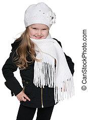 Happy little girl against the white