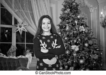 happy little girl celebrate winter holiday. Christmas party time. happy new year. christmas time. Cute little child girl with xmas present. delivery christmas gifts