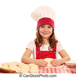 happy little girl cook kneading dough