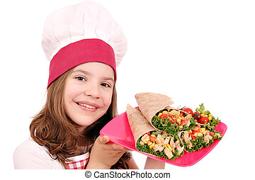 Happy little girl cook with burritos