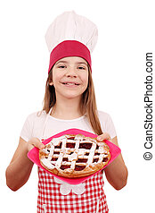 happy little girl cook with cherry pie on plate