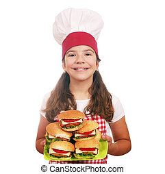 happy little girl cook with hamburgers