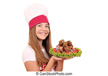 happy little girl cook with meatballs on plate