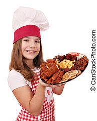 happy little girl cook with mixed grilled meat on plate