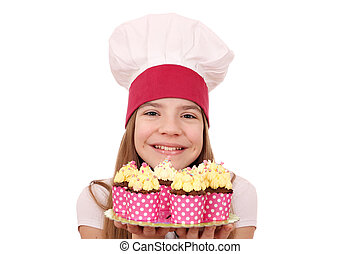 Happy little girl cook with muffins dessert