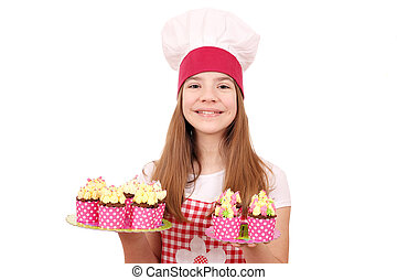 Happy little girl cook with muffins