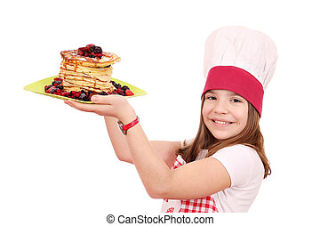 happy little girl cook with pancakes