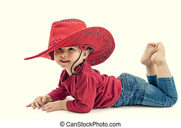 Happy little girl cowboy in a red hat on a white background