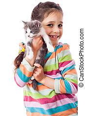 Happy little girl cuddle kitten, isolated on white