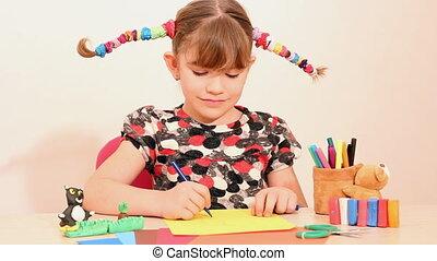happy little girl drawing