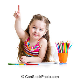 Happy kid little girl drawing with pencils in preschool