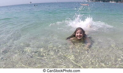 happy little girl fun in sea summer vacation