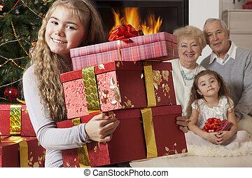 Happy little girl getting Christmas presents
