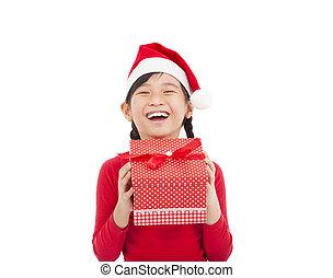happy little girl holding christmas gift