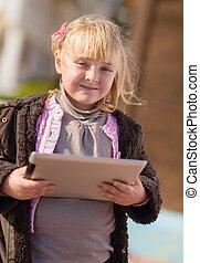 Happy Little Girl Holding Digital Tablet