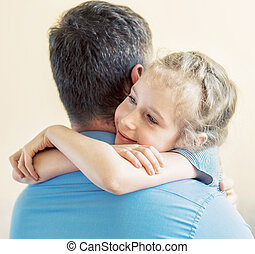 Happy little girl hugging his dad.