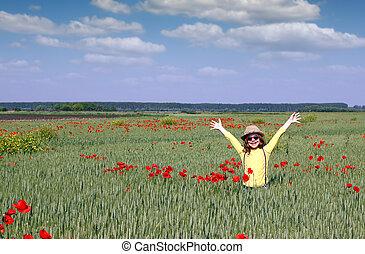 happy little girl in a meadow