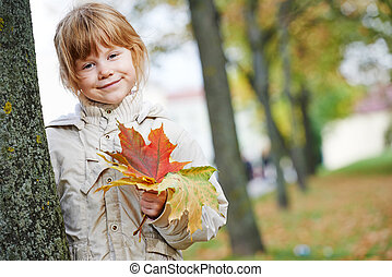 Happy little girl in autumn