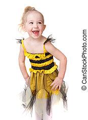 happy little girl in bee dress