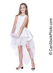Happy little girl in carnival costume posing on white background