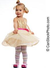 Happy little girl in golden dress isolated on white