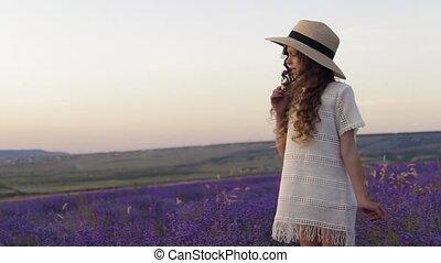 Happy little girl in lavender field in slow motion - Happy...