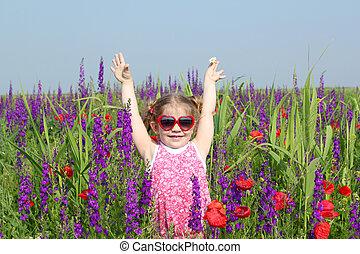 happy little girl in meadow