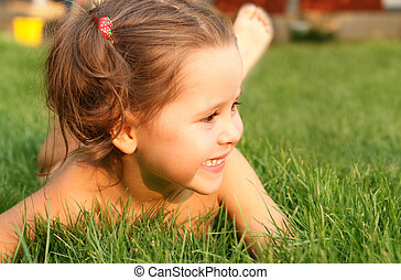 Happy little girl in the grass