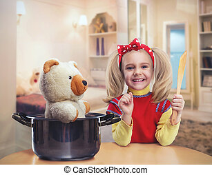 Happy little girl in the kitchen