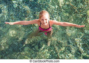 Happy little girl in the sea