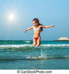 Happy little girl  in the sea