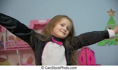 Happy Little Girl Is Dancing - Happy little caucasian white...
