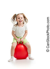 happy little girl jumping on bouncing ball. Isolated on white.