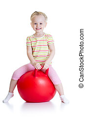 happy little girl jumping on bouncing ball