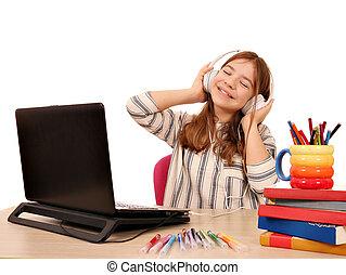 Happy little girl listening music on headphones