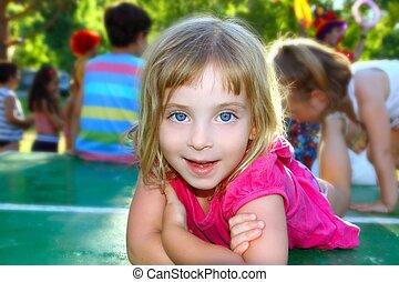 Happy little girl lying on table tennis park