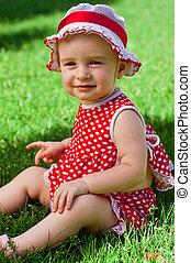 Happy little girl on a lawn