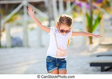 Happy little girl on beach vacation