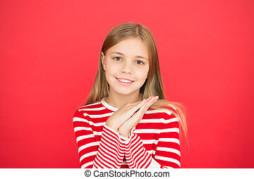 happy little girl on red background. family and love. childrens day. Good parenting. Child care. small girl child. School education. Childhood happiness. Looking for inspiration