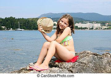 happy little girl on summer vacation