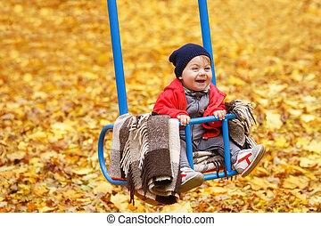 happy little girl on swing