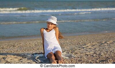 Happy little Girl on the beach.