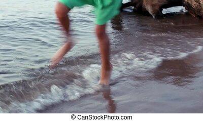 Happy little girl on the beach sports