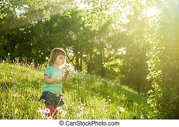 Happy little girl on the field