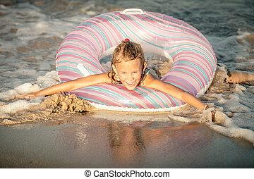 Happy little girl on the sea