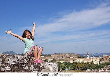 Happy little girl on vacation Corfu town Greece