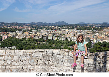 happy little girl on vacation in Corfu town Greece