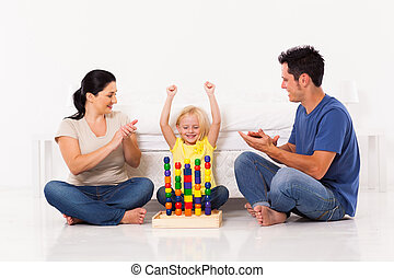 happy little girl playing toys
