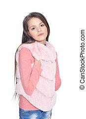 Happy little girl posing in fur waistcoat