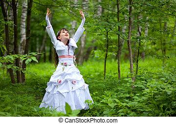 happy little girl raises her hands up